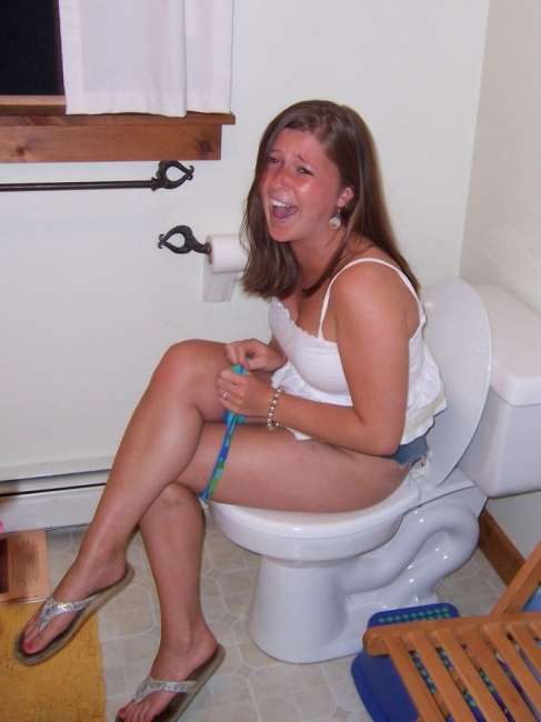 Girls Caught Sitting On The Loo 01