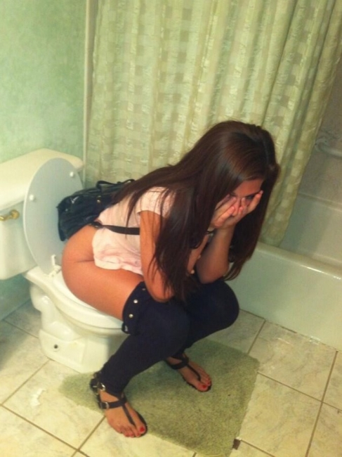 Girls Caught Sitting On The Loo 18