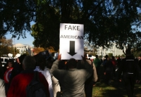 Protester Signs 13