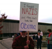 Protester Signs 16