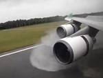Airliner Landing On A Very Wet Runway