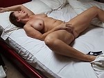 MILF On Her Back Rubbing One Out Is Pretty Damn Hot