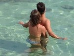Not So Subtly Wanks Off Her Man In The Ocean