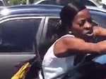 Angry Woman Trashes A Car Who Knows Or Cares Why