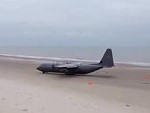 Army Plane Takes Off From A Beach