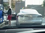 Blonde Stopped At The Gas Station To Fill Up Her Tesla