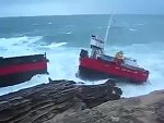 Cargo Ship Smashed Against Rocks After Breaking Its Mooring
