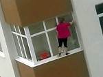Cleaning Her Apartment Windows Without A Care In The World
