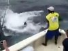 Deckhand Goes Overboard Trying To Pull In A Big Fish