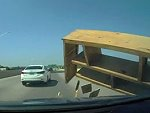 Encounters A Piece Of Furniture On The Highway