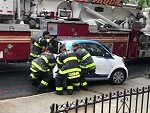 Firefighters Move A Smart Car Out Of Their Way
