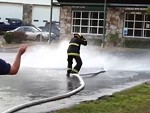 Fireman Tries To Catch A Wild Hose