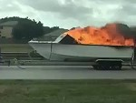 Flaming Boat Driving Down The Highway