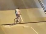 Foolish Cyclist Tries To Ride Over A Draw Bridge