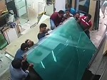 Glass Sheets Fall And Trap Workers Against A Bench Ouch
