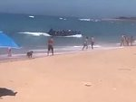 Immigrants Illegally Entering Spain Through A Busy Beach