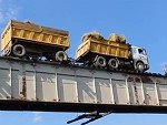 Large Truck Bravely Crossing A Train Bridge