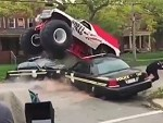 Monster Truck Takes On A Couple Of Cop Cars