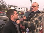 Old Timer Punches A Reporter In The Face