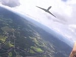 Parachutist Almost Taken Out By A Passing Jet Airplane