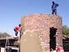 Plasterers At Work Somewhere In The Third World