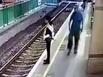 Psycho Pushes An Woman On To The Rail Tracks In Hong Kong