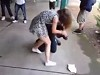 Schoolgirl Kicks A Dudes Butt Then Bails Before She Gets Busted