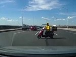Scooterer Idiotically Goes The Wrong Way Across A Freeway