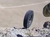 Soldiers Let A Tyre Go Down A Mountain
