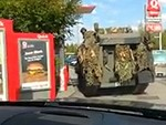 Soldiers Take Their Tank Through A Drive Thru