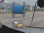 Someone Somehow Lost A Cable Drum On The Freeway