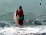 Speedos Guy Walks Into The Ocean With A Net