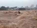 Surfer Makes The Most Of Raging Flood Waters