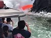 Tourists Get In Close To Watch Lava Spill Into The Ocean