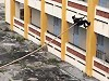Vietnamese Cops Easily Climb A Building