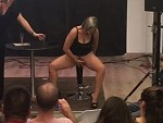 Woman On Stage Giving An Instructional Squirting Demo