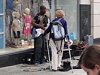 Woman Tries To Silence Street Performer But The Audience React In An Amazing Way